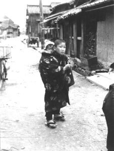 A boy babysitting in Tsuda, photograph taken by Mr. Sakai Yoshimori.