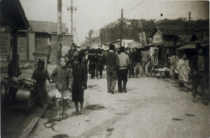 A view of Shinmachi Bridge from Motomachi which shows that reconstruction is gradually taking place (1948).